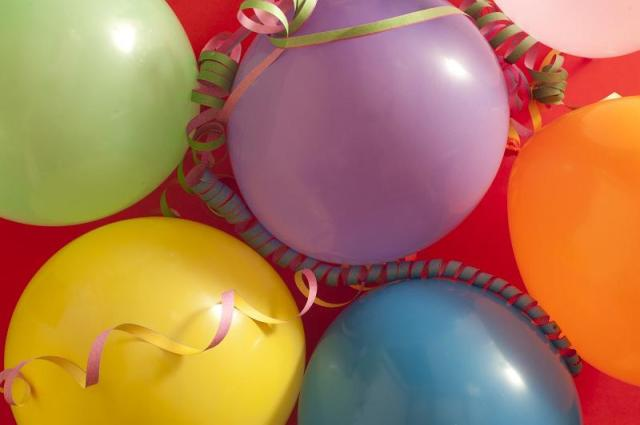 Party balloons with streamers